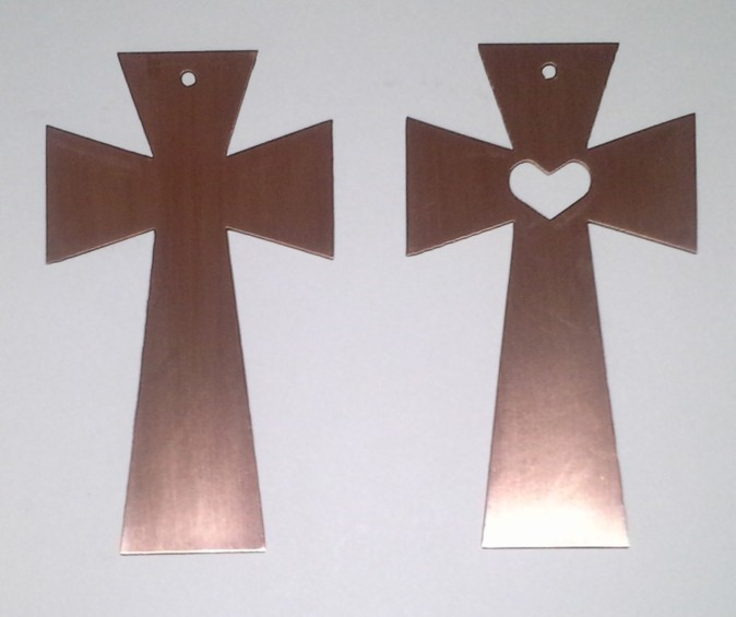 Copper cross to hang on a wall or shelf