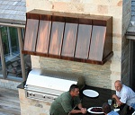 Copper range hood over grill