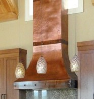 Crescent Range hood with hammering and clavos