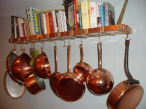 Copper and brass pot rack bookshelf